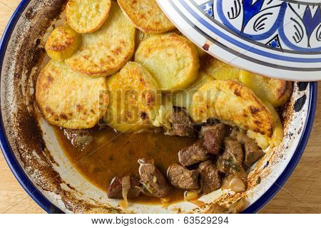 Moroccan sweet potato and beef tagine cooked in the bowl, from above. A traditional dish from Fez