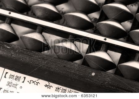 Old Abacus And A Paper