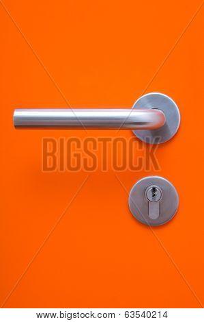 The Part Of Orange Door With Metal Handle