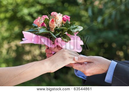 Apology With A Bouquet Of Flowers
