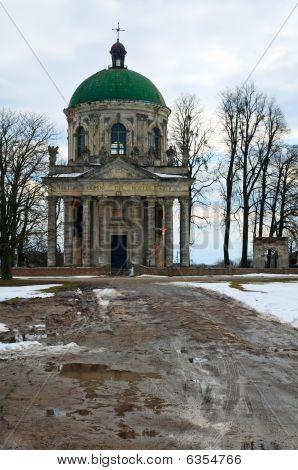 Spring Pidhirtsi Roman Catholic Church And Dirty Road Evening View