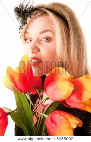 Pretty Young Blonde Woman With Plastic Flowers