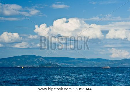 Sea, Sky, Clouds And Ship.