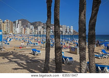 Benidorm, Costa Blanca, Spain - April 2014: Playa De Levante, Benidorm, Tourists on the beach.