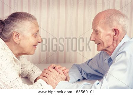 Closeup portrait of smiling elderly couple.