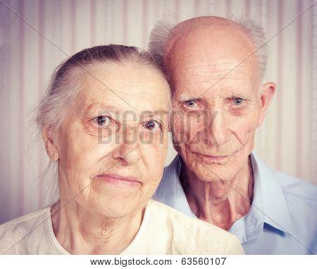 Closeup portrait of smiling elderly couple.