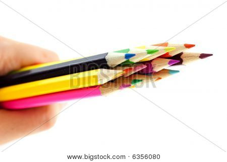 Crayons In A Hand On White Background