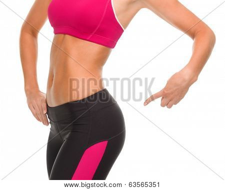 fitness and diet concept - close up of sporty woman pointing at her buttocks