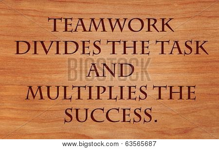 Teamwork divides the task and multiplies the success - quote by unknown author on wooden red oak background