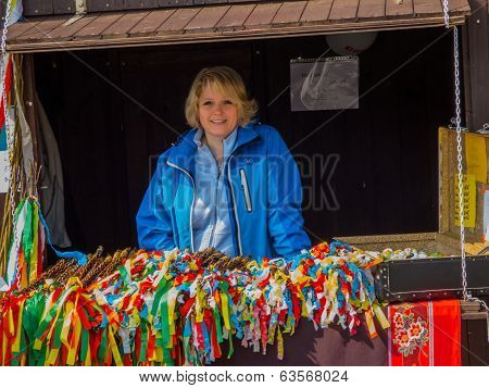 Seller in a Stall at Easter Fair in City Most