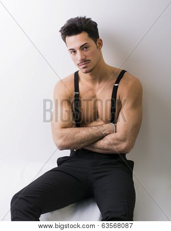 Shirtless Athletic Young Man With Suspenders And Black Pants