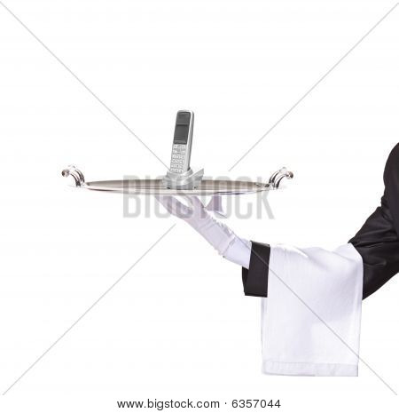 Waiter Holding A Silver Tray With A Phone On It