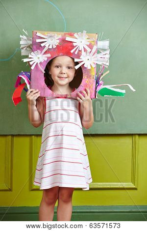 Female kid with DIY costume for carnival in kindergarten