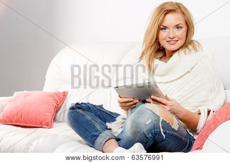 Closeup portrait of woman resting with tablet computer