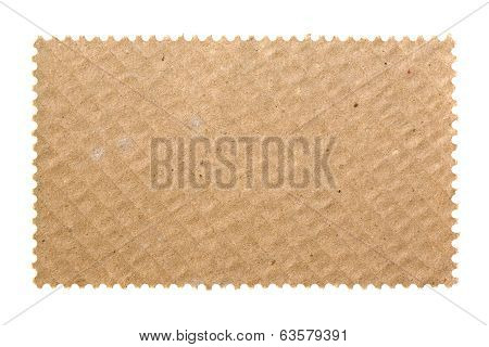 Blank postage stamp with cardboard background