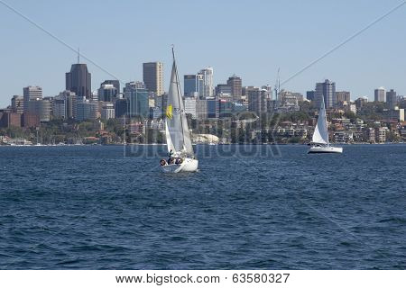 Sydney, Australia-march 13Th 2013:: Yachts Sailing In Sydney Harbour With The Cbd In The Background.