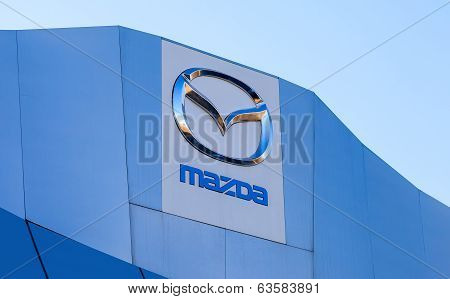 Samara, Russia - April 19, 2014: The Emblem Mazda On Blue Sky Background. Mazda Motor Corporation Is