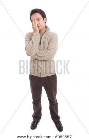 Young Casual Man Full Body With A Headache, Isolated On White