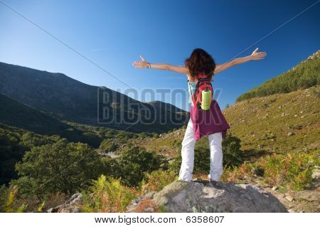 Open Cross Arms Woman Over Valley