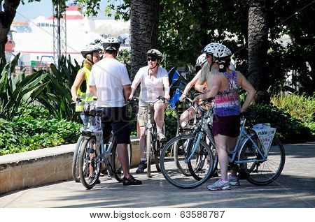 Cyclists in park, Malaga, Spain.