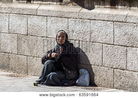 Belgium, city of Leuven, woman beggar, April 2014