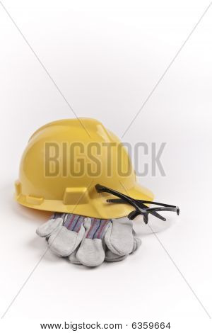 yellow hard hat safety glasses and leather gloves