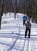 stock photo of nordic skiing  - Active Baby Boomers on the nordic ski trails in Ontario - JPG