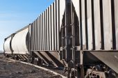 stock photo of railcar  - Empty railcars waiting on a siding to be loaded with grain from the local silo - JPG