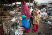KATHMANDU, NEPAL - DEC 19, 2013: Unidentified local children near their homes in a poor area of the