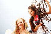 foto of hair blowing  - Photo of joyful females drying their hair and having fun - JPG