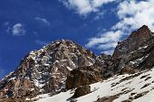 foto of taurus  - Rocks with snow at nice spring day - JPG