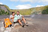 pic of volcanic  - Couple hiking on volcano on Hawaii looking at map - JPG