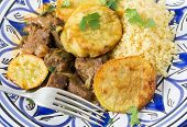 stock photo of tagine  - Moroccan sweet potato and beef tagine with couscous - JPG