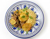 picture of tagine  - Beef and sweet potato tagine served with couscous and a coriander garnish on a handmade north - JPG