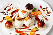 picture of kumquat  - Creamy ice cream topped with sliced kumquat and served with meringue biscuits drizzled with fruity syrup for a tasty summer dessert - JPG