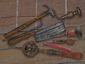 vintage woodworking tools over weathered drift wood background