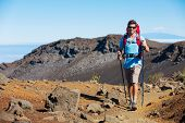 Hiker enjoying walk on amazing mountain trail. Backpacking in Haleakala volcano, incredible view. Tr