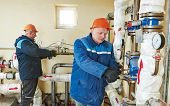 pic of manometer  - repairman engineer of fire engineering system or heating system open the valve equipment in a boiler house - JPG