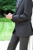 foto of nonverbal  - A businessman wearing a black elegant suit - JPG