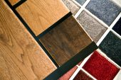 stock photo of glass-wool  - Oak wood flooring samples and colorful carpet samples