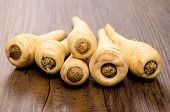 image of parsnips  - Stack with parsnips on a wooden table - JPG
