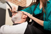 stock photo of barber razor  - Low angle view of a female barber shaving a man - JPG