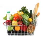 stock photo of grocery cart  - Shopping basket filled with fresh fruit and vegetables - JPG