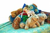 stock photo of stuffed animals  - Old stuffed animals lying on a bed in a day care back yard - JPG