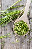stock photo of chives  - Wooden Spoon with fresh Chive  - JPG