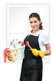 stock photo of women rights  - Spring cleaning Woman with black apron holding a red Cleaning Brush in left hand and a basket full of cleaning products in right hand - JPG