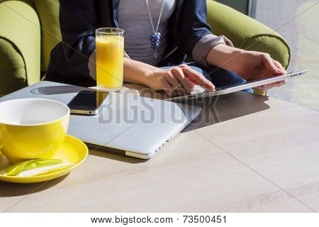 Woman using her mobile devices in cafe