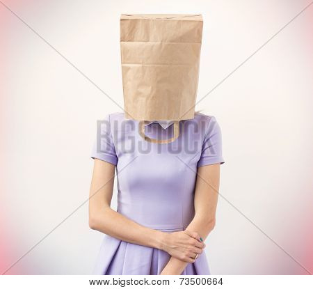 Woman with paper bag over her head
