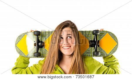 Skater With Green Sweatshirt Over White Background