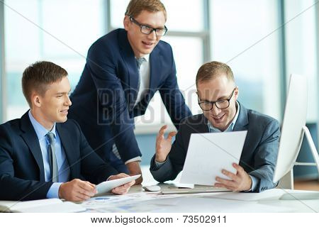 Businessman presenting results to his colleagues